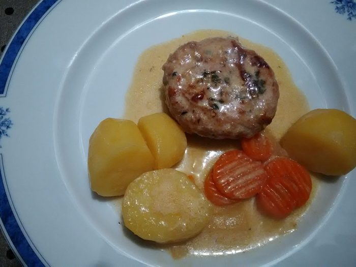 Flat white wine sausage in a pork fat caul and potatoes